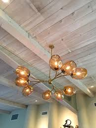custom made staccato branch globe chandelier in light amber