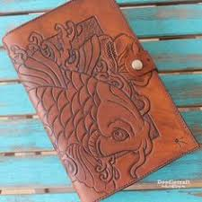 leather tooled book cover with koi and hibiscus