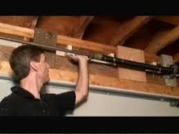 how to remove garage door header sag