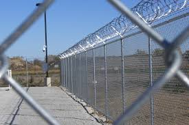 black vinyl coated 8u0027 tall galvanized with barb wires and razor wire at a commercial project chain link fence barbed e87 chain