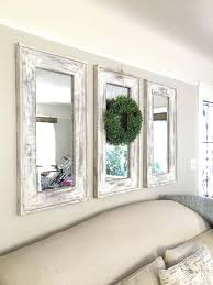 retrofitted wall mirrors with natural wreath accent