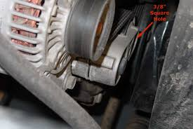 jeep l serpentine belt replacement com step 2 finding the belt tensioner and wrench pivot hole