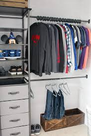 awesome closet organizer in a teenage boys closet has combination of open storage shelves