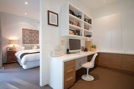 Image Apartment Wooden Cabinets Bring Warmth To The Home Office In White Next To The Master Bedroom Decoist 20 Ways To Decorate Home Office In White