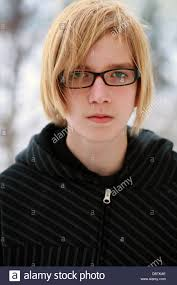 Blonde teen in glasses