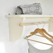 vintage styled wooden clothes rail with top shelf