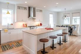 white flat front cabinets with light gray quartz countertops