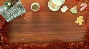 table top background. Table Top Background Video With Christmas Ornaments, Cookies And A Cup Of  Coffee. Hand Places Red Gift Box On The Table Takes Coffee Stock
