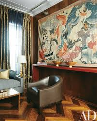 a tapestry by roland oudot commands one end of the room the herringbone floor is