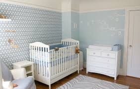 Inspiration for a contemporary boy medium tone wood floor nursery remodel  in San Francisco with blue