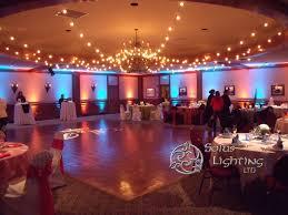 Fun wedding reception lighting! String lights hung over the dance floor, a  custom monogram