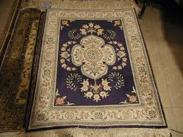 white and tan hereke fl chinese rug