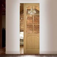 single pocket doors. deanta louis oak syntesis pocket door with clear bevelled glass, unfinished single doors