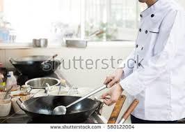 busy restaurant kitchen. Chef In Hotel Or Restaurant Kitchen Busy Cooking