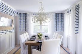 blue and white coastal dining room with graphic wallpaper