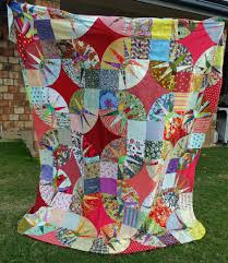 big city quilt   Little Birdie Quilting Studio & The pattern is by Victoria Findlay-Wolfe from her book Double Wedding Ring  Quilts. It is just an over-sized DWR, with big pieced points to form the  large ... Adamdwight.com