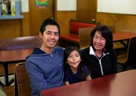cevin lee poses with his daughter alana and mother phan ly at hong kong express on south grand boulevard