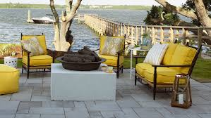 Image Pool Patio With Yellow Cushions And River View Coastal Living 65 Beachy Porches And Patios Coastal Living