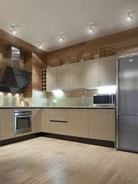 led track lighting for kitchen. led kitchen track lights over decorative wicker baskets above particle board cabinets on maple wood veneer lighting for