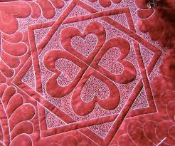 Quilt Stippling and Meandering Stitches & Red and Pink Quilt with Hearts Design Adamdwight.com