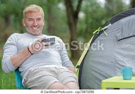 Download this free photo about young handsome man drinking coffee outside and using phone, and discover more than 7 million professional stock photos on freepik. Man Drinking A Coffee Outside A Tent Canstock