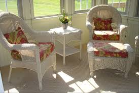 dark gray wicker armless chair using blacklinen fabric upholstered red and yellow flower pattern linen fabric wicker chairs cushion pad