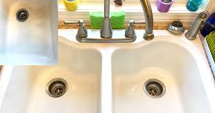 bar keepers friend cleans iron from porcelain sink
