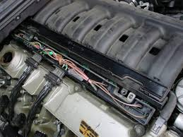bmw e36 3 series fuel injector replacement 1992 1999 pelican remove the two small bolts that fasten this wire harness box to the top of the intake manifold at this point you will need to remove the connectors from