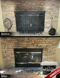 smoke stains on a stone fireplace before and after being cleaned with paint n
