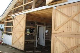 exterior sliding door hardware. exterior sliding barn door hardware with crossed braces and unpainted wood a