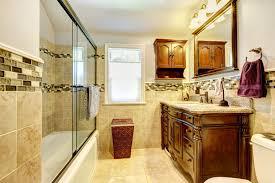 beige bathroom with porcelain stone look tile and granite vanity countertop