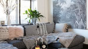 grey living room with grey palm print mural