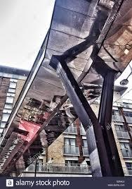 Steel Walkway Design An Urban London Street Reflected In The Underside Of A