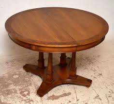 antique round extending walnut dining table