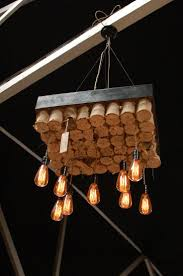custom big daddy s antiques light fixture made from boxed bed springs and edison bulbs