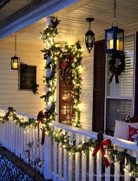 outdoor candles lanterns and lighting.  lanterns a bunch of ideas here christmas front porch with hanging candle lanterns   i can do this on my patio but will gave to use an alternative light source in  on outdoor candles lanterns and lighting