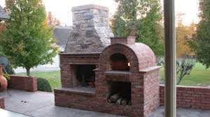 build your own outdoor fireplace designs with brick fence in concrete flooring