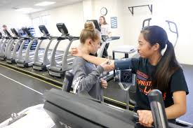 at union county s academy for allied health sciences danielle dror left checks the blood pressure of fellow junior alyssa carbonell in their exercise