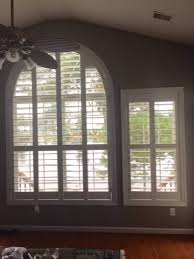 arched windows and rectangular window both look great with custom window coverings our plantation shutters