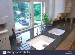 Kitchen Granite Worktops Kitchen Sink With Granite Worktops In A Brand New Kitchen Stock