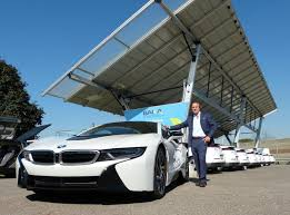 john marion founder and president of baka communications stands with his personal bmw i8