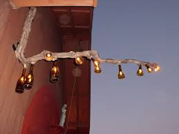 interesting wine bottle chandelier design gor your traditional outdoor patio area