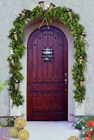 exterior outdoor front door decorations with black painted door plus round green garland and