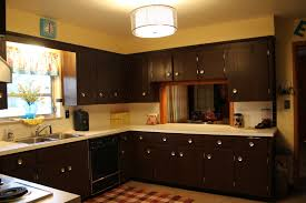 Yellow Kitchen Countertops In Vogue Drum Ceiling Lamps Over Modern Espresso Cabinets With