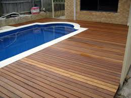 Wood Pool Deck White Pool With Brown Wooden Deck Plus Grey Wooden Fence And Brown
