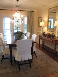 i made a set of dining room chairs similar to these made out of drop cloth slipcovers