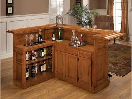 this wood bar includes a wrap around upper counter as well as a behind bar furniture designs