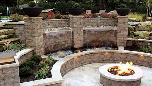 firepit backyard patio water lighting retaining wall concrete block wall