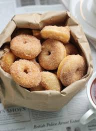 a simple mini baked donut recipe with cinnamon and sugar this recipe can be used with a mini donut pan or a mini donut maker