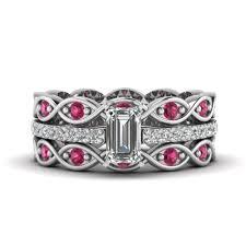 infinity engagement ring set. white gold emerald cut infinity band engagement ring set